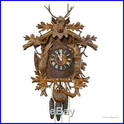 Black forest carved wood cuckoo and quail clock with deer head