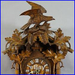 Black forest carved wood cuckoo clock with bird on top