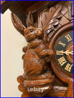 NOS Vintage Germany Cuckoo Black Forest Carved Wood Figural Hunting Wall Clock