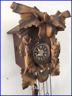 Vintage German Wooden Hunter Themed Cuckoo Clock With Chimes & Music